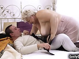 Busty granny Astrid welcomes..